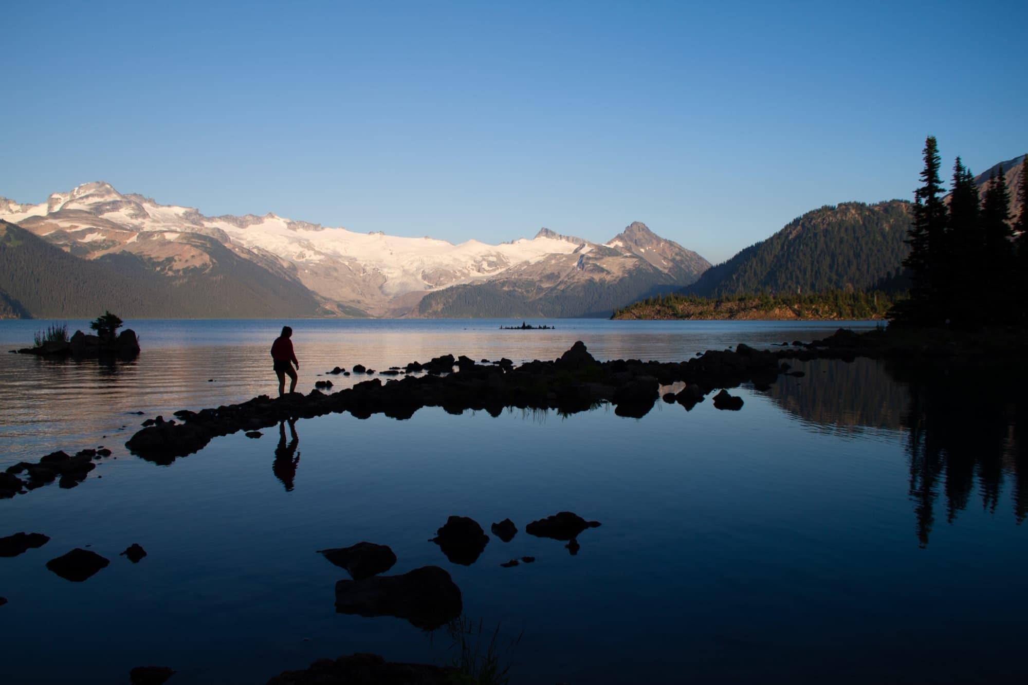 Figure walking on rocks at Garibaldi Lake