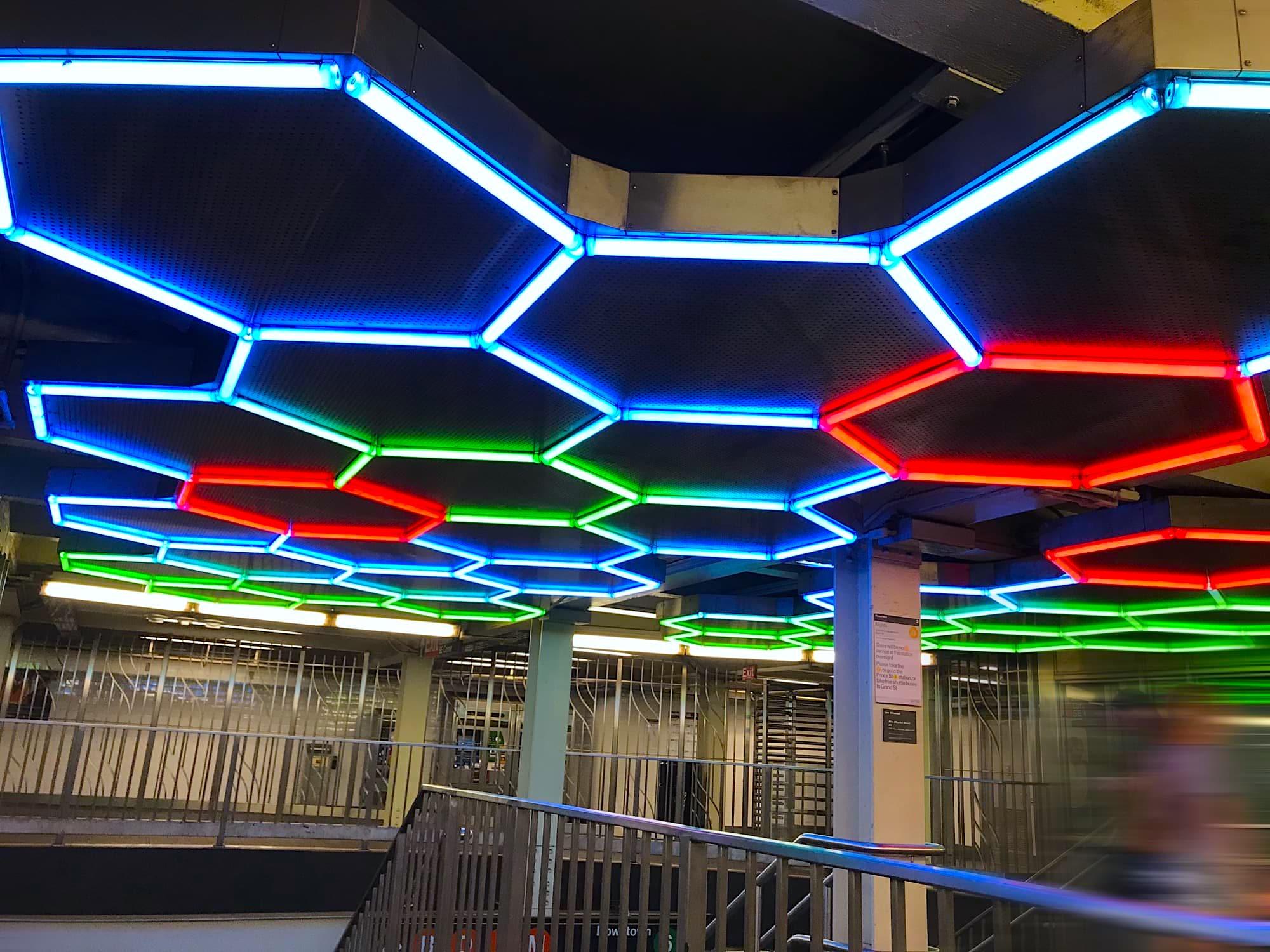Photo of hexagonal light show installation at Bleecker Street Subway Station